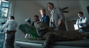 Cage is seen here interacting with a pair of iguanas he is hallucinating. Just another tuesday.
