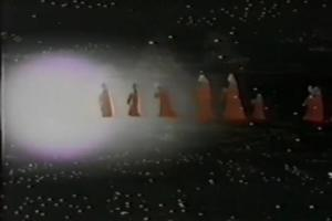 Maybe someone more versed in Star Wars lore can help me out here... How exactly is dressing up in Snuggies and walking into a white hole related to the Wookiees' Christmas equivalent?